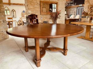 1. pre-owned X frame round table, 72_ diam, character oak, antique light finish - 2