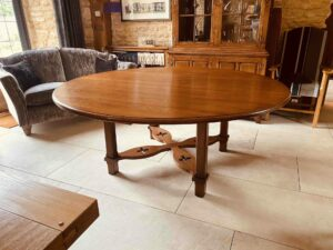 1. pre-owned X frame round table, 72_ diam, character oak, antique light finish