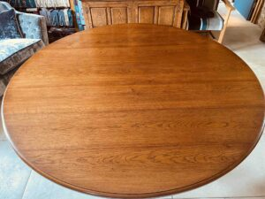 1. pre-owned X frame round table, 72_ diam, character oak, antique light finish - top