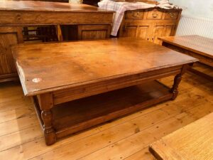 102 pre-owned coffee table with potboard, 2 plank top, 60_ x 36_, character _ burr oak, Norfolk medium finish