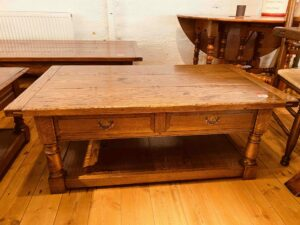 103 pre-owned coffee table, two drawers and potboard, 48_ x 27_ x 19_, character oak, antique light finish