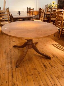 5. pre-owned pedestal base round table, 48_ diam + 1 x 18_ ext leaf, antique light finish