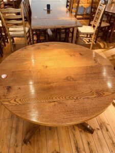 5. pre-owned pedestal base round table, 48_ diam + 1 x 18_ ext leaf, antique light finish - top