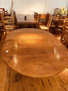 5. pre-owned pedestal base round table, 48_ diam + 1 x 18_ ext leaf, antique light finish - top with ext leaf