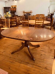 5. pre-owned pedestal base round table, 48_ diam + 1 x 18_ ext leaf, antique light finish - with ext leaf