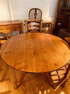 7. pre-owned round pedestal base table, 48_ diam, cherry, medium _ golden finish - top