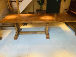 new - 8. Refectory table on twin turned pillar base, top 78_ x 36_ + ext leaf of 21_ attached, (1981 x 915mm + ext leaf of 535mm), character oak, antique light finish, seats 6_10, £4,190