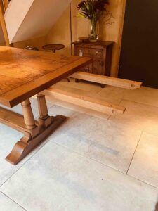 new - 8. Refectory table on twin turned pillar base, top 78_ x 36_ + ext leaf of 21_ showing ext bearers, (1981 x 915mm + ext leaf of 535mm), character oak, antique light finish, seats 6_10, £4,190